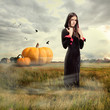 Young girl wearing witch costume, halloween time