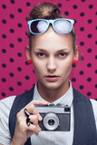 Fashionable teen with old camera in shirt and bow-tie