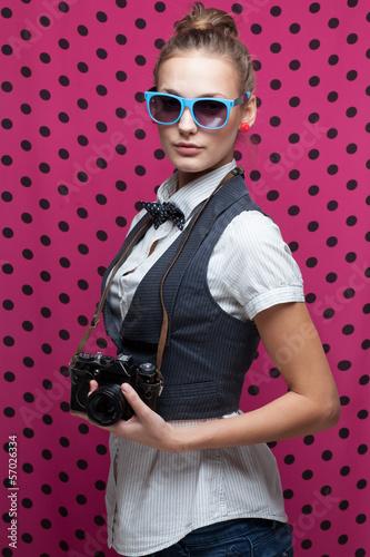 fashionable teen girl with vintage camera
