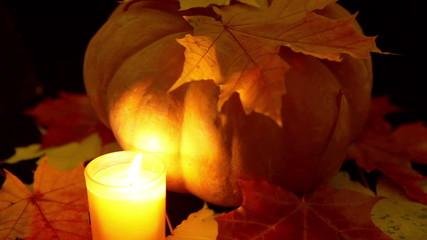 The candle burns before pumpkin. Halloween