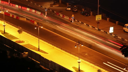 Night city road time lapse cars move leaving long traces