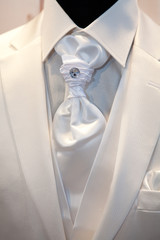 Groom's wedding suit detail on a mannequin