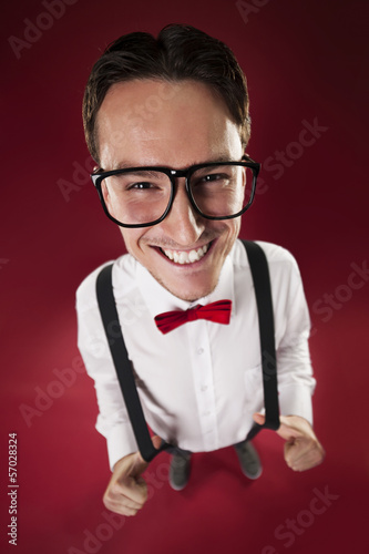 Portrait of nerdy man wearing red bow tie and suspenders