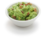 guacamole dip in bowl isolated on white background