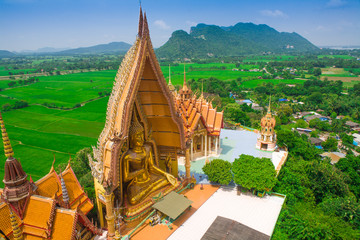 Big golden Buddha in temple, Kanchanaburi Thailand