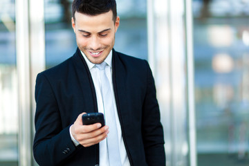 Businessman reading a sms