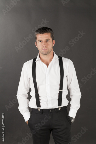 men in white shirts and suspenders