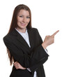 Pointing businesswoman with brunette hair