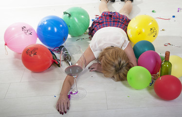 Party goer sleeping it off facedown on the floor