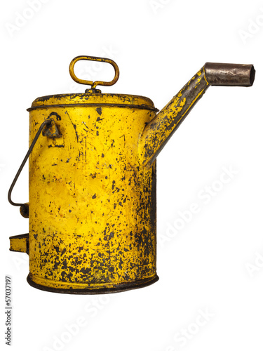 Vintage yellow oil can isolated on white