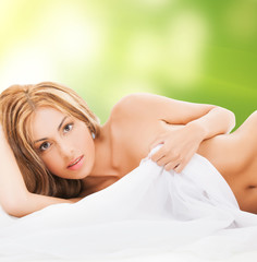 beautiful naked woman in the bed