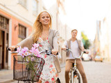 couple with bicycles in the city - Fine Art prints