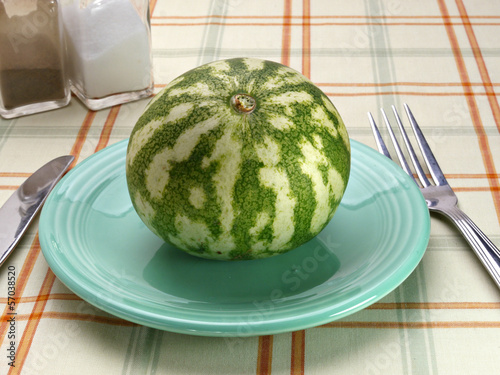 Watermelon on a blue saucer