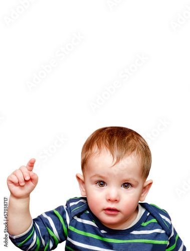 Portrait of beautiful child pointing finger