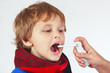 Little sick boy used medical spray for breath