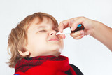Little boy used a medical nasal spray in the nose