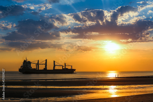 Silhouette of a ship on a sunset horizon