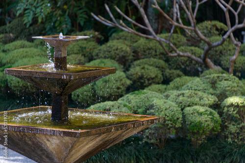 Square fountain in an Asian garden - 57039781