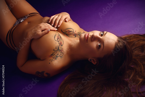Beautiful brunette topless in a studio