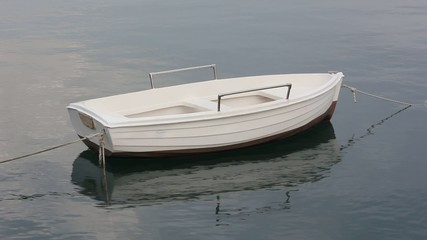 Small White Boat Floating