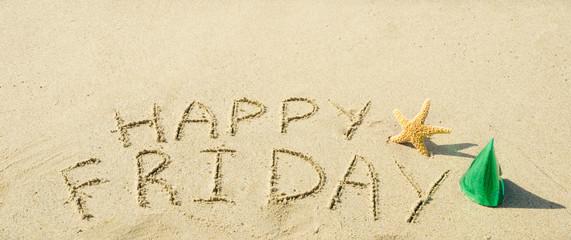 "Sign ""Happy Friday"" on the sandy beach"