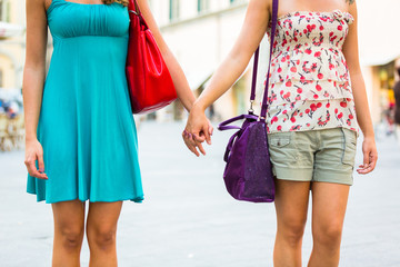 Two Women Holding Hands in the City