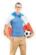 Young sport fan with flag of Holland holding a soccer ball