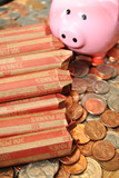 Rolled Pennies with a Piggy Bank and Coins