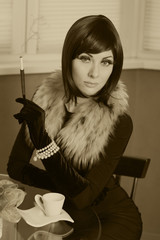 Retro styled woman with cigar