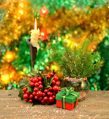 Conifer branches with candle and gift
