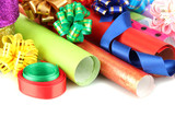 Fototapety Rolls of Christmas wrapping paper with ribbons, bows isolated