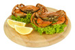 Boiled crabs on wooden board, isolated on white