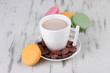 Cocoa drink, macaroni and cocoa beans on wooden background