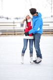 Ice skating couple on date in love iceskating