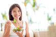 Leinwanddruck Bild - Healthy lifestyle woman eating salad smiling happy