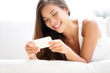Smartphone woman using app smiling happy