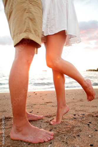 Love - romantic couple dating on beach kissing