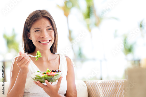 Leinwanddruck Bild Healthy lifestyle woman eating salad smiling happy