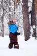 Portrait of cheerful boy in winter forest