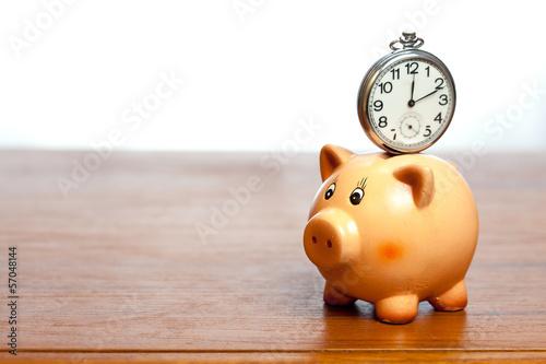 canvas print picture Clock on a piggy bank