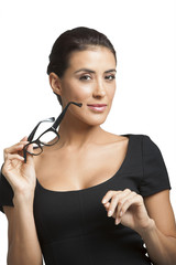 Businesswoman holding eyeglasses