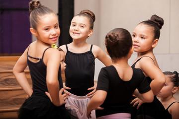 Happy little girls in ballet class