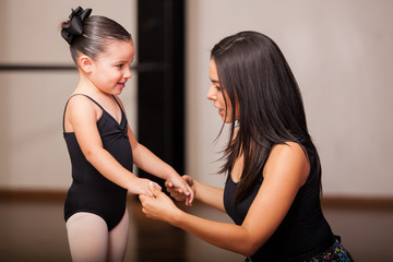 Dance instructor with a student