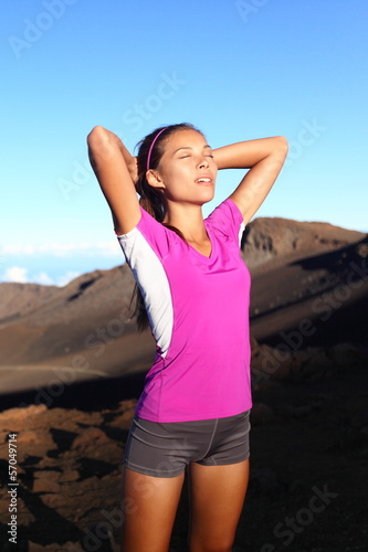 Athlete runner woman relaxing after running