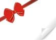 rote Schleife mit gerollter Papierecke