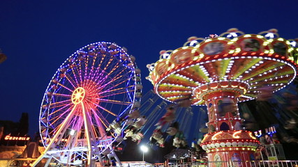 Swing and Ferris Wheel at amusement park