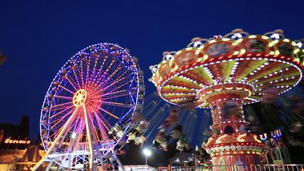 Swing and Ferris Wheel at amusement park