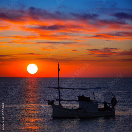 Ibiza sunset  view and fisherboat formentera