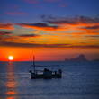 Ibiza sunset Es Vedra view and fisherboat formentera