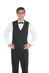Attractive young waiter posing smiling at camera